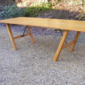 Oak dining table with steel supports